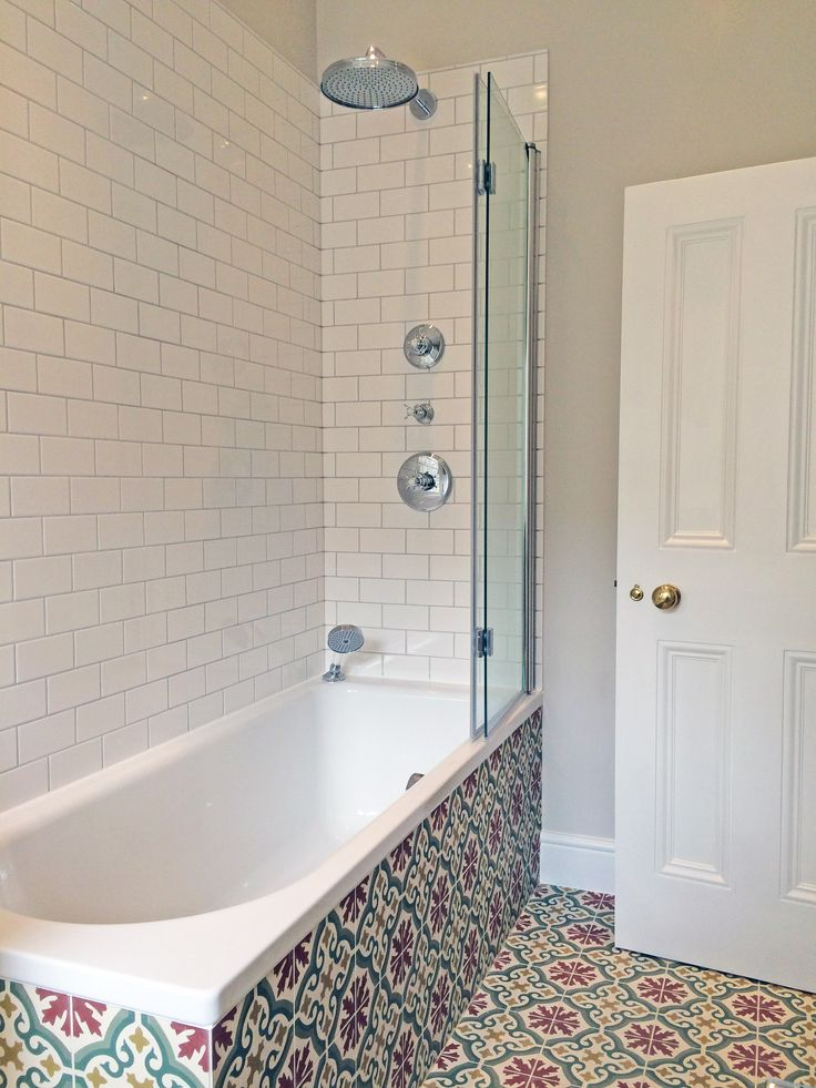 Finished Bathroom With Beautiful Traditional Styled Tiles On The Floor And  Side Of Bath