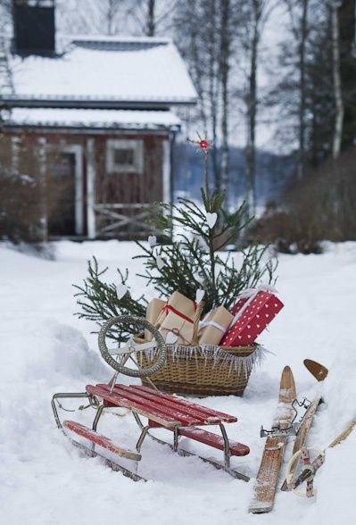 Sled, Skis and basket with gifts-neat outdoor vignette.                                                                                                                                                                                 Plus