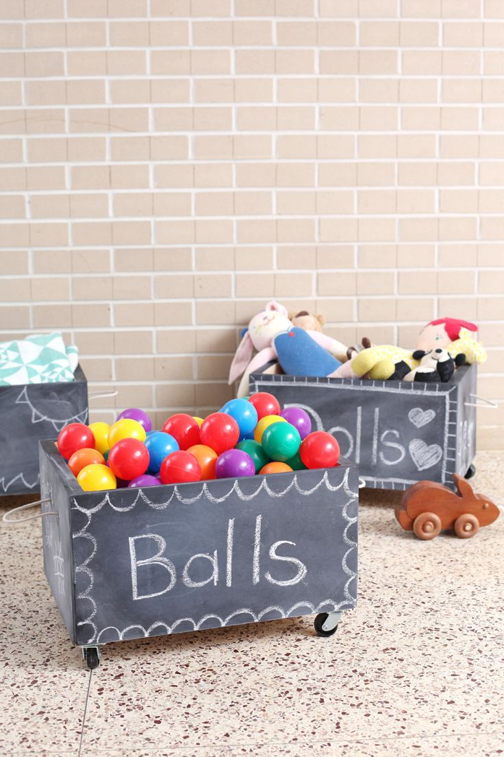 Make your own rolling chalkboard toy box using a crate as a base. Click through for instructions from A Beautiful Mess Blog. #playroom #kids