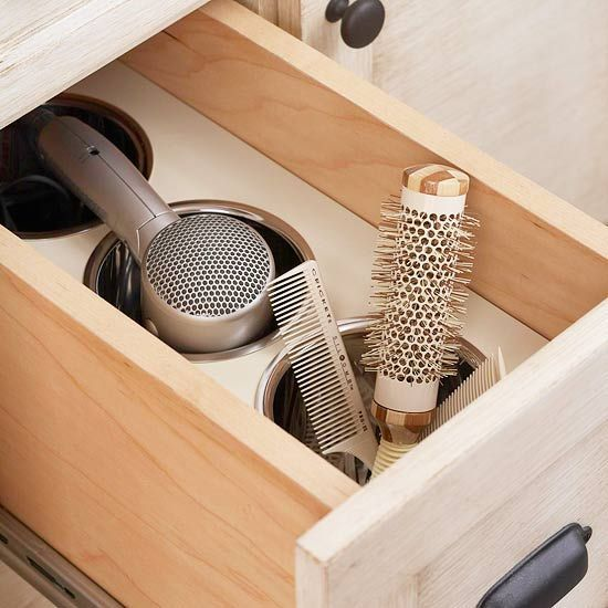 Customize Cabinets --A deep drawer can safely hold a hot hair dryer and other primping tools after use. Here, custom-fit stainless-steel canisters allow beauty tools to cool safely inside the drawer as well as house them.