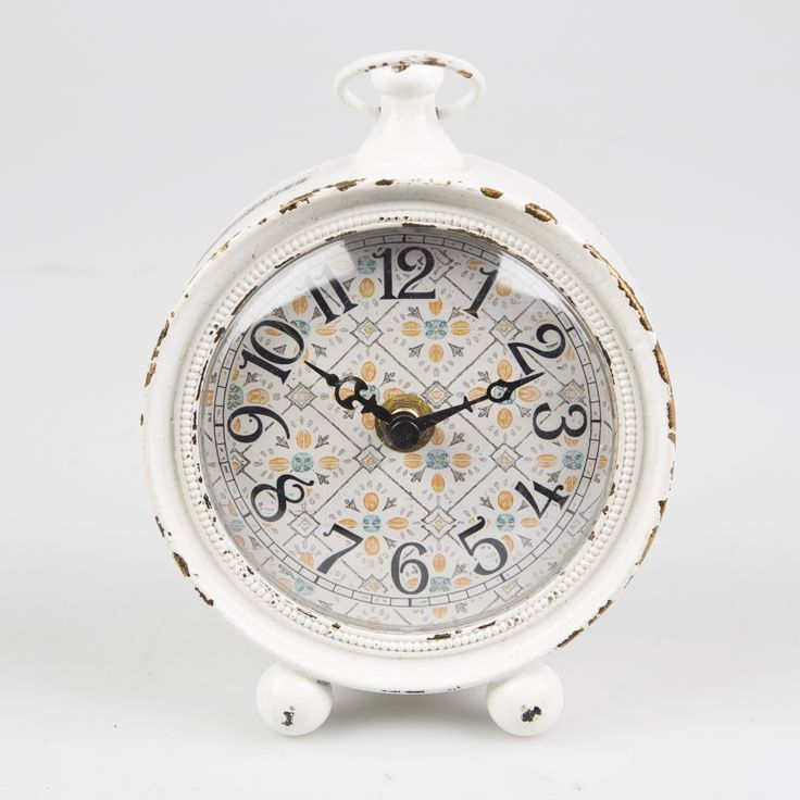 This beautiful Modern Morocco Station Clock is in the carriage clock style.  It is made out of white coloured pewter in a vintage finish. The clock face is a mixture of traditional and modern turkish styles and the beautifully fretworked reverse