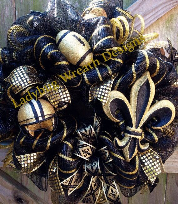 NEW ORLEANS SAINTS DECO MESH FOOTBALL WREATH - A beautiful wreath to show your support and love for your Saints!! It is made with premium