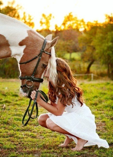 Too bad this girls face is covered up. Super cute picture. The horse looks like what Nova will grow up to look like:)