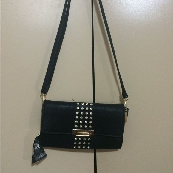 Black studded purse Black studded purse that can be used with or without straps. Never used. Tags still attached. Bags