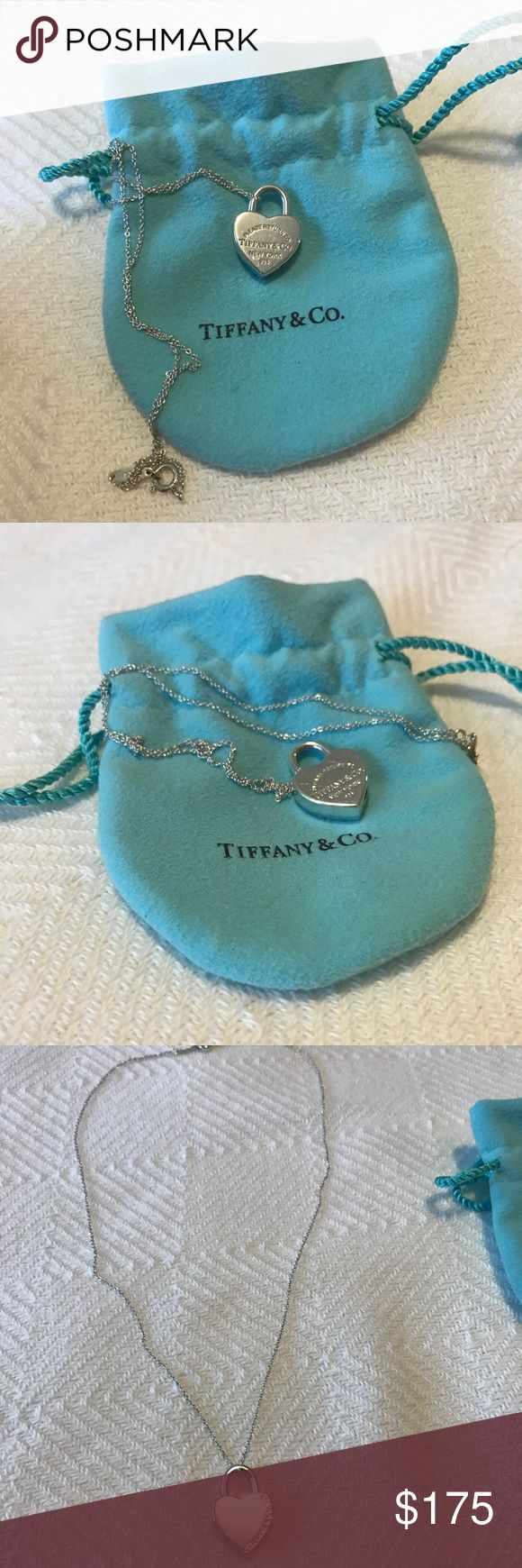 "Tiffany & Co. heart locket pendant necklace 100% Authentic Tiffany & Co. heart locket necklace, sterling silver, EXCELLENT condition.  Engraved ""Return to Tiffany & Co. New York 925"". Great everyday piece! Comes with signature Tiffany & co jewelry pouch. Tiffany & Co. Jewelry Necklaces"