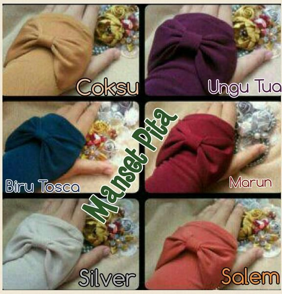 Handsock/Manset Jempol Pita  Handsock atau manset tangan, dengan lubang di bagian jempol serta aksesori pita cantik, dapat digunakan untuk hijaber yang lengan bajunya pendek atau utk menutup pergelangan tangan agar lebih syar'i. Ket : panjang 40 cm (bahan elastis sehingga bisa ditarik lebih panjang hingga 5-7 cm), manset terdiri dari 1 pasang (kiri dan kanan)  Bahan : jersey balon super  Stok warna ready : - Coksu (on mod) : ready - Ungu tua (on mod) : ready - Biru tosca (on mod) : ready…