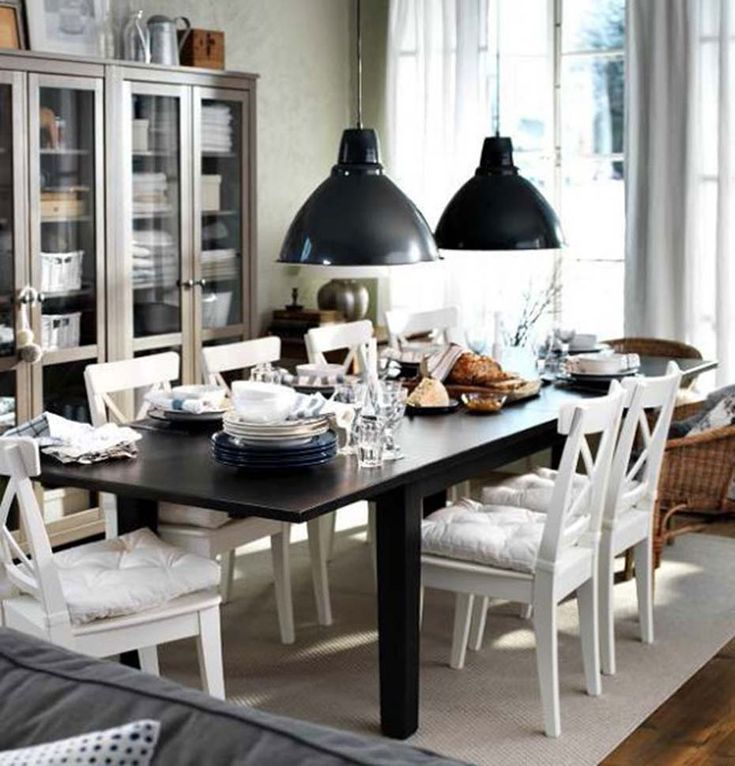 IKEA Dining Room   Dark Wood Table Paired With White Chairs