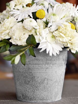 Age a shiny galvanized bucket with a few spritzes of bleach, then use as a vase.: Galvanized Buckets, Wedding Ideas, Bucket Centerpiece, Shiny Galvanized, Wedding Reception, Weddingideas, Wedding Centerpieces
