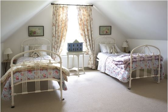 Lovely attic room with two twin beds.  In England