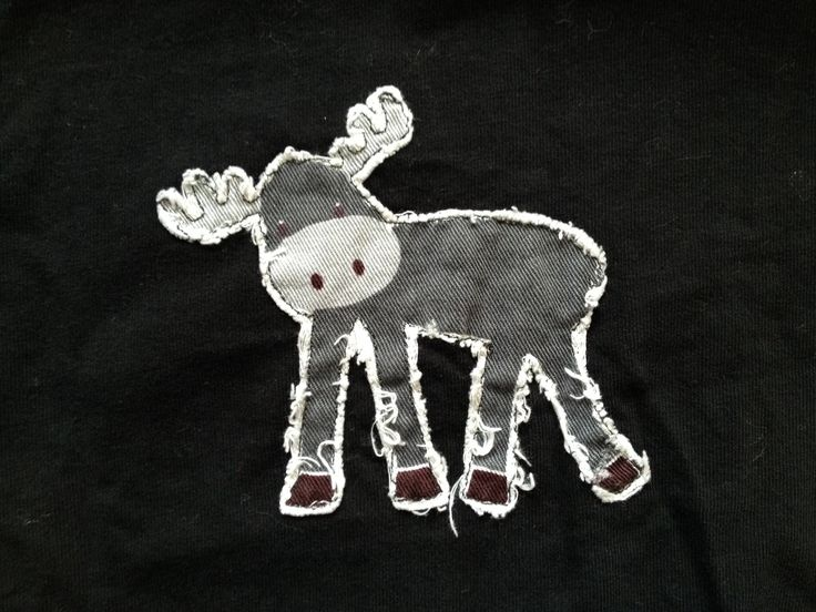 Free motion appliqué on my sons shirt - I saw this fabric at spotlight and thought the moose would be great on a shirt