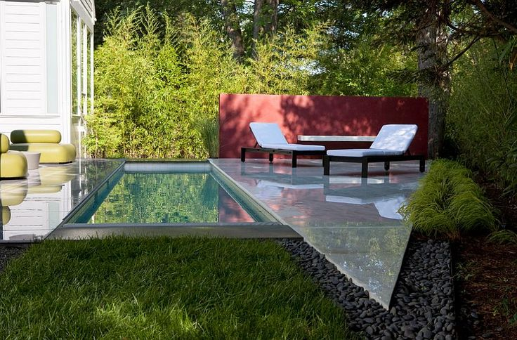 Narrow pool plays to the dimensions of the modern house [Design: Anthony Wilder Design]