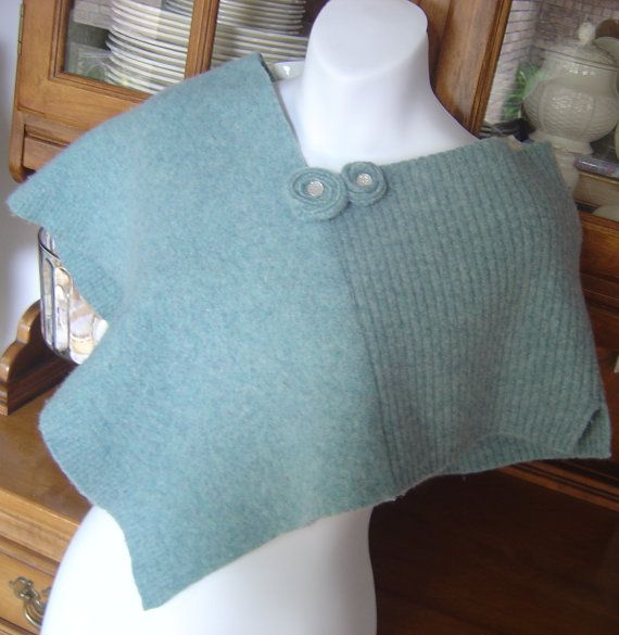 This is a capelet/poncho/shawl that has been recycled from wool sweaters. Lambswool.  The sweaters have been washed and felted for a very warm fabric.  Will fit most sizes and can be worn several ways. Probably fit xs to medium the best, but depends how you wear it. Could be worn by a larger child.  There is a pin with sparkles in the middle that can be worn in different places on the poncho or can be used on other clothing items.  Eco-friendly. Hand washable with pin removed.  Great paired…