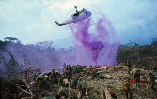 Smoke flares marks the landing spot for an evacuation helicopter coming in to take out U.S. calvarymen wounded in the battle for control of the vital A Shau Valley. 30 Apr 1968