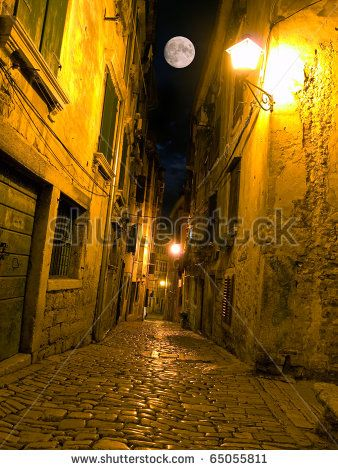 Night view of a street typical for Mediterranean architecture. - stock photo