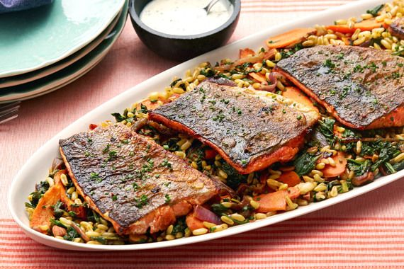 Paprika & Fennel-Spiced Salmon with Pan-Roasted Vegetables & Khorasan Wheat. Visit https://www.blueapron.com/ to receive the ingredients.