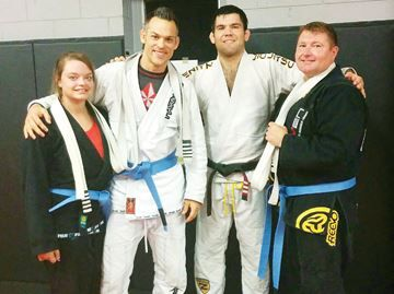 Jiu-jitsu expert awards athletes blue belts in Midland - Driven Jiu-Jitsu recently welcomed six-time world champion Robert Drysdale, second from right, to Midland.