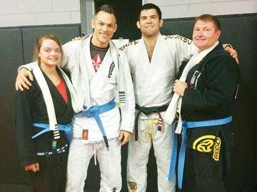 Jiu-jitsu expert awards athletes blue belts in Midland - Driven Jiu-Jitsu recently welcomed six-time world champion Robert Drysdale, second from right, to Midland.