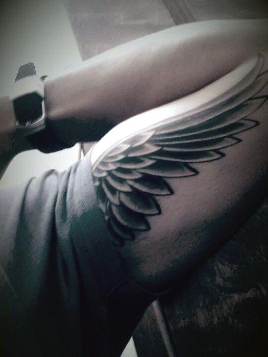 Guys Bicep Tribal Wings Tattoos