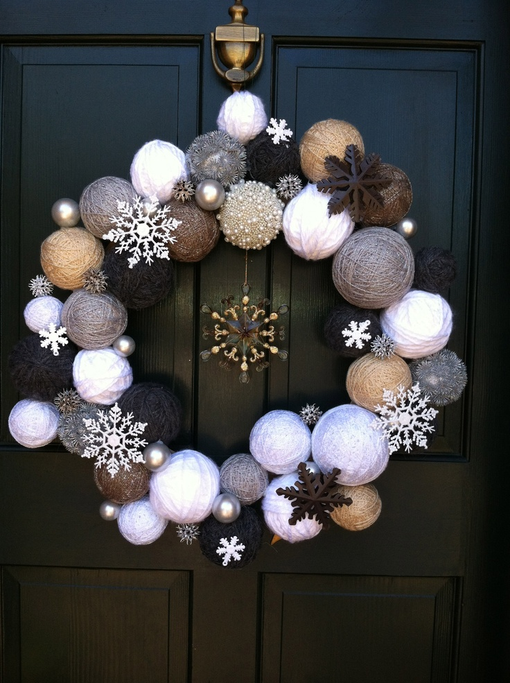 Winter wreath. Wrap styrofoam balls with different shades of yarn. Other ornaments and snow flakes. Hot glue all onto a flat wreath form from craft store. Someone else made this and I loved it! So I had to make my own.