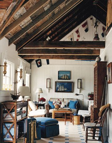 Living Room; Pierre Frey's Turenne stripe covers the dining chair cushions and the living room sofa. The exposed rafters and roof boards of the living room were left in their original state to retain the feeling of a circa-1900 fisherman's cottage. Sofa by Bielecky Brothers....wow