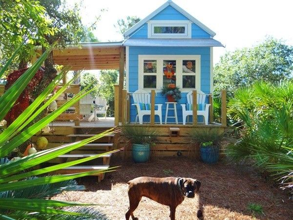 I love this house! The inside is really cute, and it uses my two favorite colors.  Tiny Beach Cottage with Two Lofts