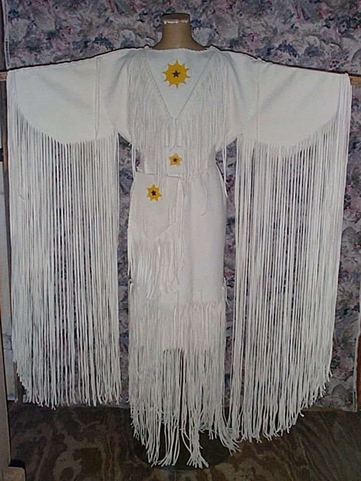 White elk hide dress with beadwork. This dress will be custom made from suede side out elk hide and seed bead applique beadwork. Also included is a belt and possible bag also with beadwork http://nativeamericanstuff.net/Native%20American%20Style%20Crafted%20Clothing%20buckskins%20outfits%20moccasins%20and%20Handbags.htm