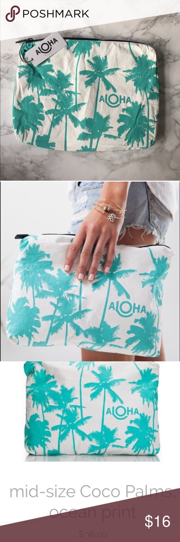 "Aloha splash proof bag / clutch from PopSugar NEW Aloha mid size travel bag / clutch from PopSugar • Take a little Kauai with you on your next adventure! This print was inspired by Kauai's coco palms and the famous Coco Palms Resort.   This pouch is perfect to use as a beach clutch.  Stow your sunscreen, sarong, and bikini, or pack toiletries for your next trip!  Mid-size pouch measures:  11.5"" across x 2"" wide x 8.5"" tall Aloha Island Bags Cosmetic Bags & Cases"