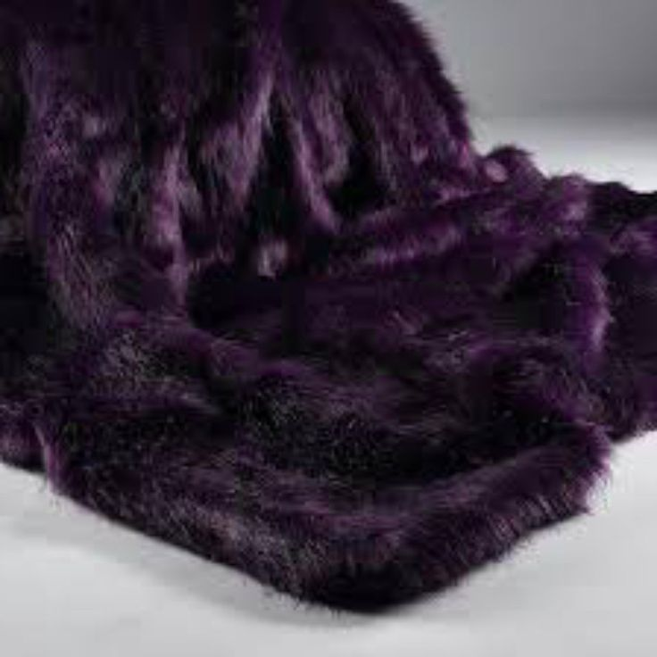 A Luxurious Faux Fur Throw In Violet With Black Strands