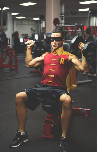 JGL. Doing shoulder presses. In full Robin gear... yum.