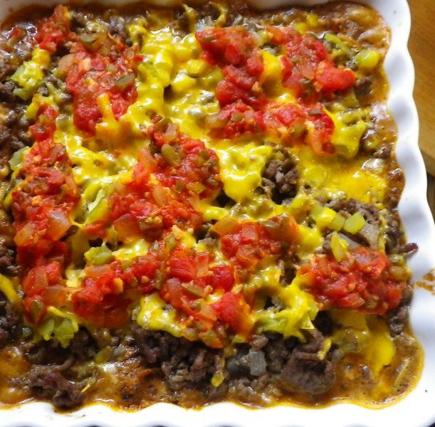 """My mom found this recipe in a magazine probably thirty years ago. This recipe is AMAZING. I don' t know exactly what sets it apart from other hot nachos recipes, but something does. You won't find a better dish to take to a party - this is probably the dish for which I'm most often asked for the recipe. They're called """"Supper Nachos"""" because they are a meal. They're a family favorite."""