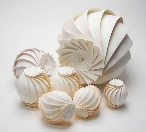 *Math + Paper Craft: Computer Scientist Creates 3D Origami - http://weburbanist.com/2012/10/25/math-paper-craft-computer-scientist-creates-3d-origami/#