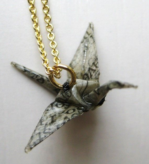 Origami jewelry made from newsprint