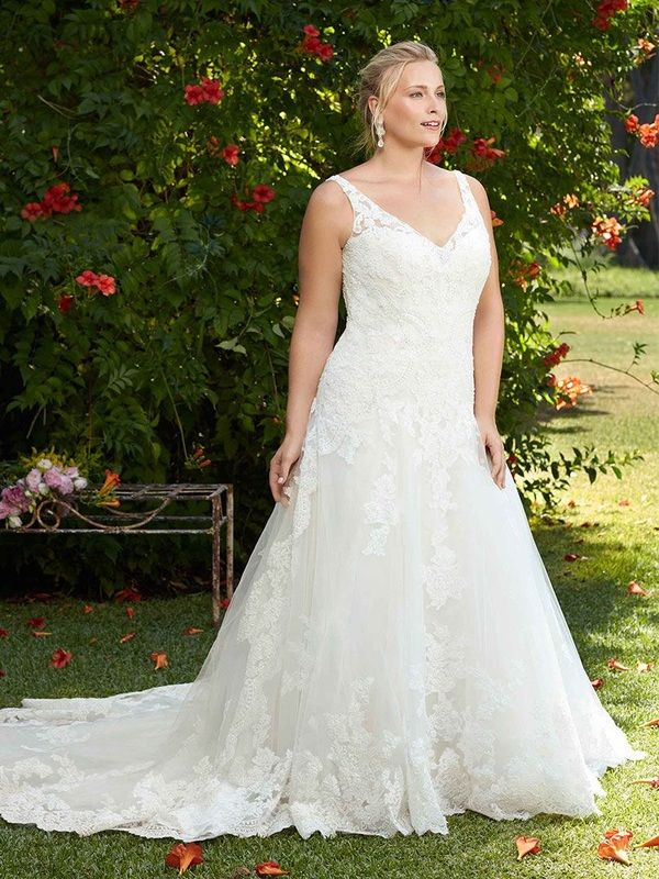 http://www.bridalshopmd.com/casablanca-2269.html Visually stunning #floral lace on Tulip #softly makes its way from the dainty #beaded #cap sleeves all the way down to the train. Tulip's #long #sleeve option enhances this #bridal #gown 's versatility. Tulle and Luxe silky charmeuse lining drape from the gown's low #illusion back, accented with a button closure. #Beaded l#ace #appliques on #tulle, with #luxe #silky #charmeuse lining #plus #size #strapless