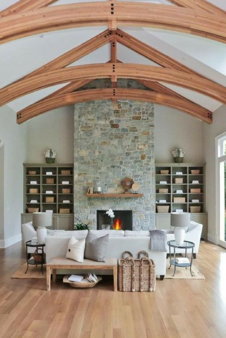 Large Living Room With Incredible Ceiling Beams Light Hardwood Floor And White Cathedral Ceiling Living Room Stone Fireplace Decor Formal Living Room Designs