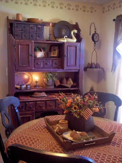 I LOVE this look, my aunt found a hutch just like this at goodwill and painted it black, looks like it came out of primitive store!!