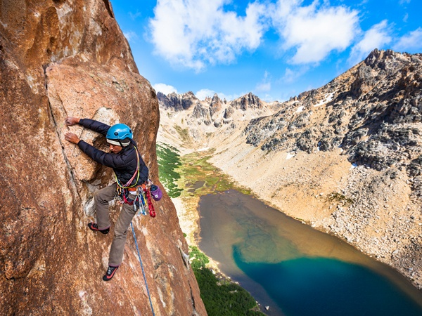 Luli Murakami climbing the Aguja Frey, Lake District of Northern Patagonia, Argentina    Photograph by Forest Woodward