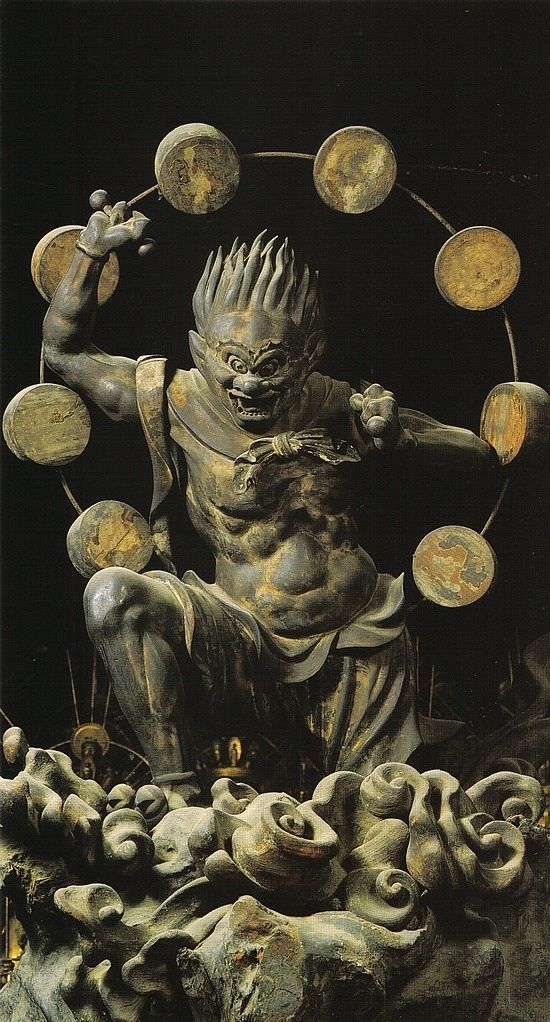 Raijin 雷神 Shinto God of Thunder holding a hammer to beat the drums that surround him. 13th century, wood, Sanjūsangendō in Kyoto. Japan