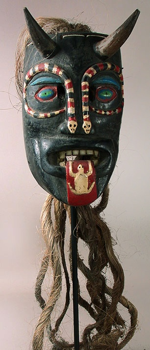 Diablo mask  Pastorela dance, Guanajuato    11 inches, painted wood, plant fiber    A classic looking Diablo with two snakes. Almost as common are frogs and lizards