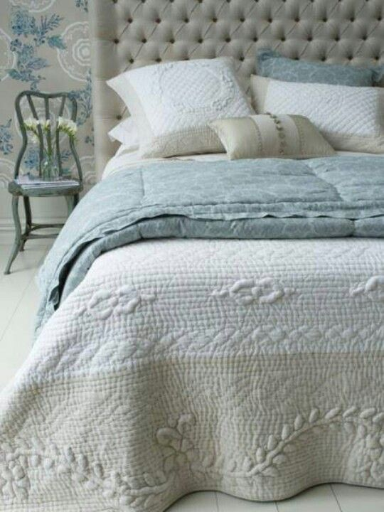 Tan, cream, and blue green bedding