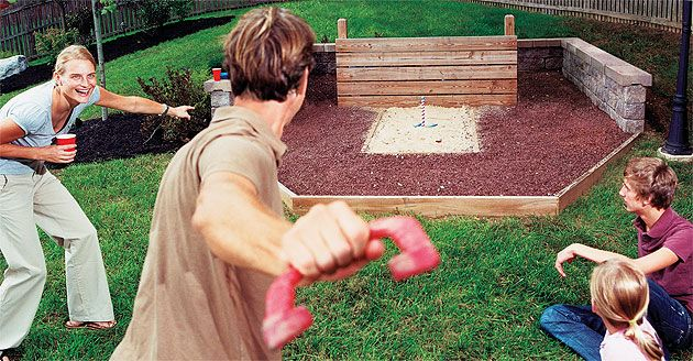 How to Build a Horseshoe Pit, Bocce Ball and Volleyball Court - Popular Mechanics - I want this type of wall around it! Makes more sitting room...