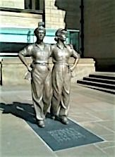 Statue of female steel workers in Sheffield during WW2, life size, erected 2016.