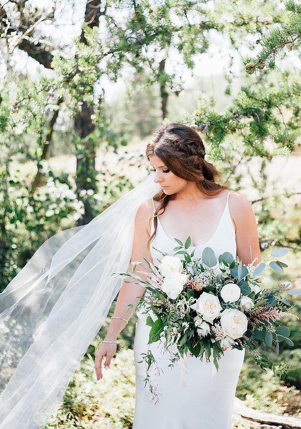 @facheflorals www.facheflorals.com | | Photo by: Pantel Photography | | #wedding #bouquet #bride #flowers #foliage #greenery #wild #organic #bohemian #summer #cabin #woodsy #bridalportrait #fashion #hair #braid #veil