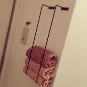 Love this idea...Japanese towel rack hack. Hang them vertically to store bathroom towels. genius!