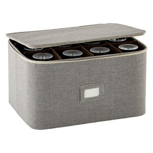 Our Stemware Storage Case is worthy of a toast because its level of protection is matched only by its chic design and stylish textured material. It accommodates goblets, wine glasses or flutes, and is structured to safeguard the contents. The cushioned dividers can be repositioned to create a custom space for an unusually sized piece. Extra padding at the top of each divider provides added protection for delicate rims.
