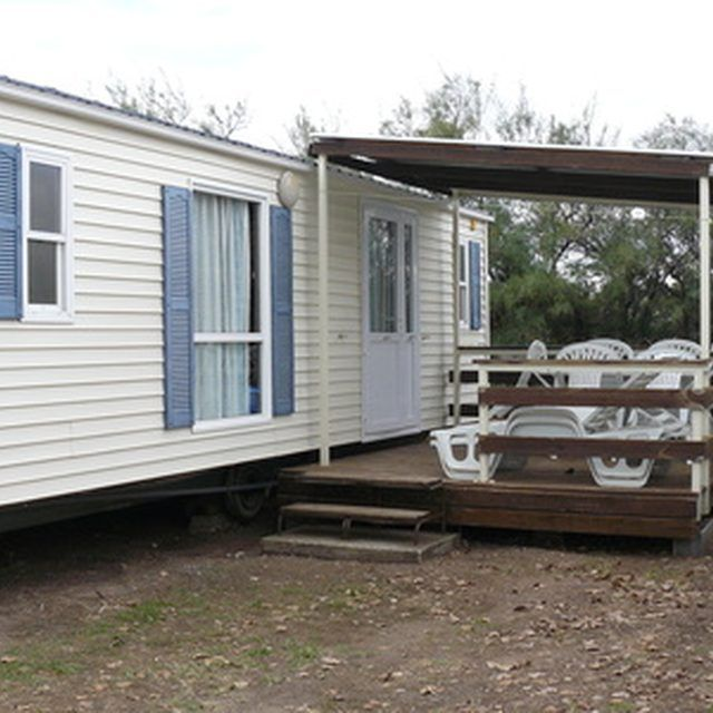Adding Porch To Doublewids: Decorating A Mobile Home Presents Challenges.