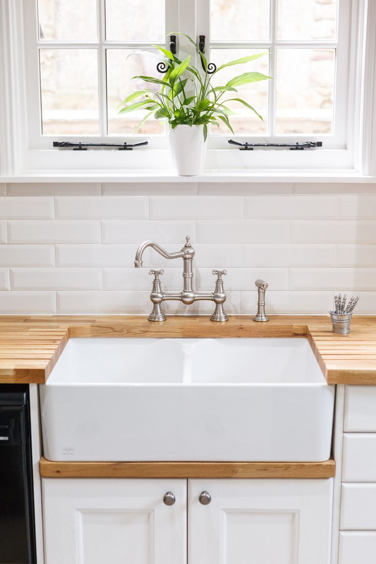 A double Belfast sink is the ideal choice for this classic country kitchen. The …,  #Belfas…