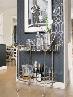 Modern two tiered bar cart with oval glass shelves & railings. Chrome tubular frame and four swivel casters makes for easy moving around the home for entertaining.