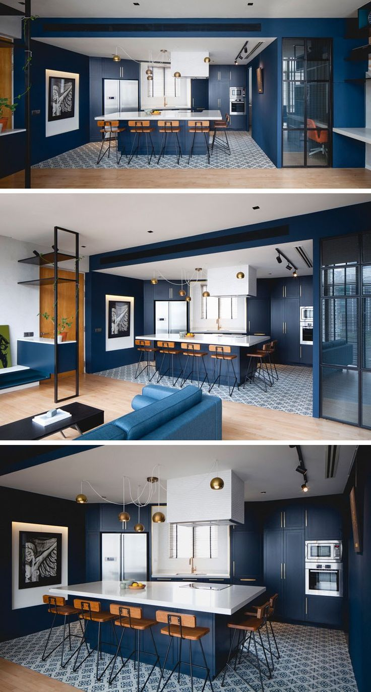 Kitchen Design Idea - Deep Blue Kitchens | Velvety blue walls and cabinetry with gold features compliment the rest of the blue in the apartment and make the whole space look put together.