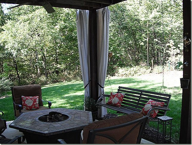 After four years, see the Update to these Outdoor Curtains .    Under the deck we have a patio, which is a perfect place to sit except for ...