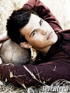 Taylor Lautner rocking the football. My daughter thinks he's hot.  Dark hair, maroon shirt, weathered football shot in the fall after wheat has been harvested = awesomeness.